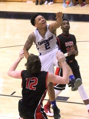 La Vergne point guard Marquis Davis goes up for a shot against Stewarts Creek. Davis' scoring will be key on Tuesday against top-ranked Blackman.