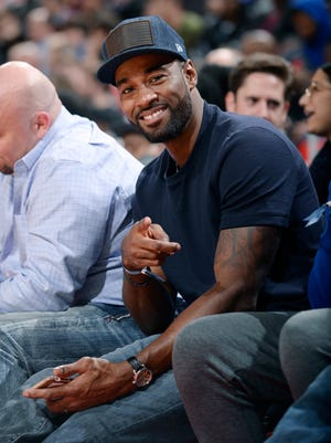 Former Lion Calvin Johnson, here at a Pistons-Cavaliers game at Little Caesars Arena, is trying to get prequalification approvals for a medical marijuana provisioning center.