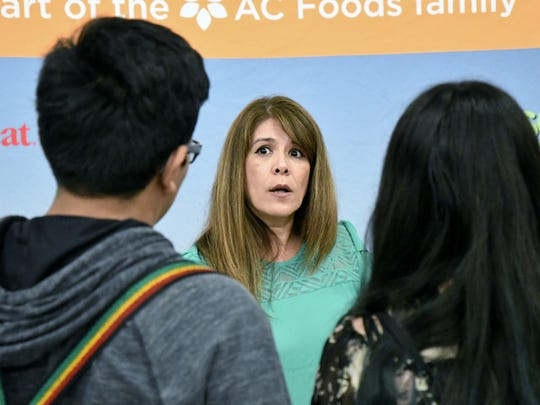 An exhibitor speaks with students at the third annual Ag Career Expo on Wednesday at the International Agri-Center in Tulare.