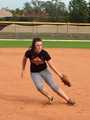 Lely junior third baseman Lily Manning races back to the bag during a team fielding drill at practice Monday, February 5.