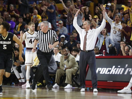 ASU's head coach Bobby Hurley pumps up the crowd against