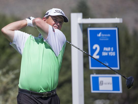 Greg Chalmers tees off on the second hole during the