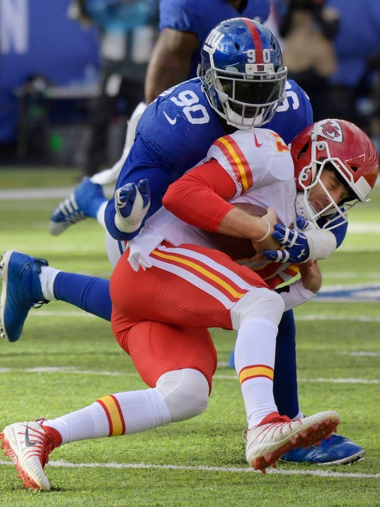 FILE - In this Nov. 19, 2017, file photo, New York Giants defensive end Jason Pierre-Paul (90) sacks Kansas City Chiefs quarterback Alex Smith (11) during the first half of an NFL football game, in East Rutherford, N.J. A person familiar with the deal says the Giants have traded defensive end Jason Pierre-Paul to the Tampa Bay Buccaneers for two draft picks. The person spoke on condition of anonymity Thursday, March 22, 2018,  because neither team has announced the deal that gets Tampa Bay the former first-round draft pick whose career was interrupted by a fireworks accident in 2015 that severely damaged his right hand.(AP Photo/Bill Kostroun, File)