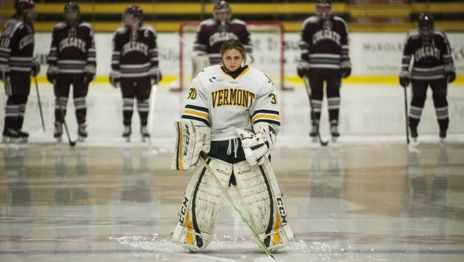 Catamounts goalie Madison Litchfield (30) stands on the blue line during the player introductions before the start of the women's hockey game between the Colgate Raiders and the Vermont Catamounts at Gutterson Field house last season.