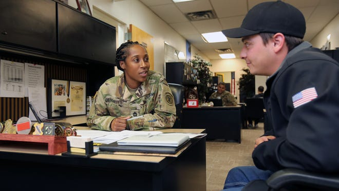 Army recruiter SFC. Latoya Descartes, chats with Michael Marrero from Mamaroneck, at the Army Career Center on Gramatan Avenue in Mount Vernon, March 7, 2017.