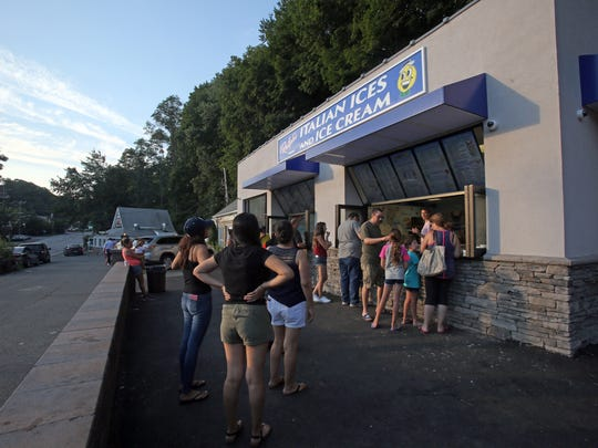 Local residents enjoy ices and ice cream at Ralph's
