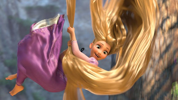 Rapunzel, voiced by Mandy Moore, has long, magical