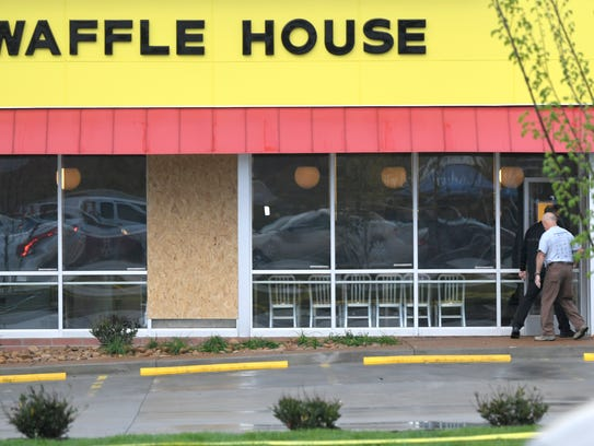 A window is boarded up at the Antioch Waffle House on Monday, April 23, 2018.