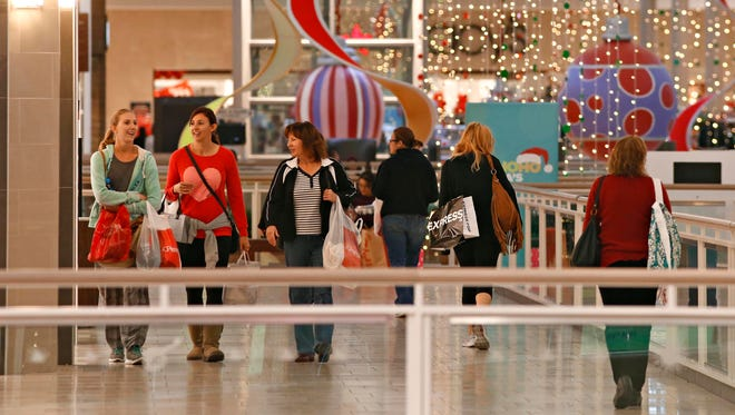 A sparse crowd walks the halls in the Arrowhead Mall in Glendale on Black Friday, November, 27, 2015.