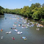 You can legally drink while tubing the French Broad, but you can't be intoxicated. More than 500 people floated down the French Broad River as part of the 2014 Asheville Zombie Float last September.