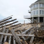 Ocean water approaches the homes at Indian Beach south of Dewey Beach on Monday, Feb. 8, 2016, with debris from the previous winter storm still waiting to be cleaned up.
