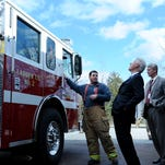 President Bill Clinton, center, looks up at a Mauldin Fire Department truck while being given a tour of the firefighting program at the Golden Strip Career Center in Mauldin, S.C., by instructor Jim Deese, left, on Thursday.President Clinton was campaigning for his wife and Democratic presidential candidate Hillary Clinton.