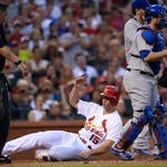 Randal Grichuk of the St. Louis Cardinals scores a run in the third inning against the Chicago Cubs on Monday in St. Louis.