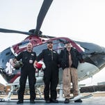 Mark Long, John Rossmiller and Joe Mulhern, regular members of the 42-person Mercy Flight team, were photographed in front of the EC-135 Mercy Flight helicopter at Benefis Jan. 21. Under the federal Airline Deregulation Act, states cannot regulate the prices, routes or services of air carriers.