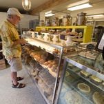 Keith Irwin, president of Old World Breads, prepares cooking pans to make cinnamon shorties at his bakery in Lewes.