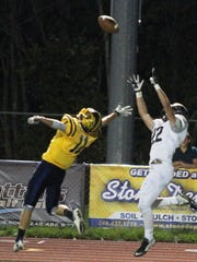 South Lyon East's Ryan Leckner (left) makes TD grab