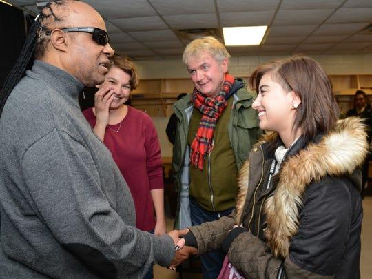 "Stevie Wonder meets with ""American Idol"" alum and Original 1265 Recordings signee Jena Irene backstage at Joe Louis Arena on Nov. 21."
