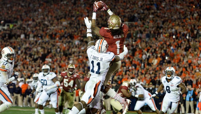 Florida State wide receiver Kelvin Benjamin catches the game-winning touchdown pass against Auburn cornerback Chris Davis in the BCS National Championship game at the Rose Bowl.  Mandatory Credit: Robert Hanashiro-USA TODAY Sports ORG XMIT: USATSI-131864 ORIG FILE ID:  20140106_jla_usa_259.jpg