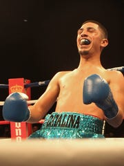 Randy Caballero rejoices after his seventh-round knockout of Miguel Robles in 2013