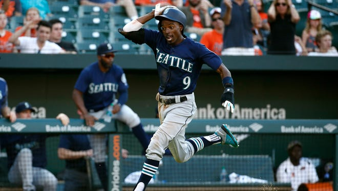 Dee Gordon scores during the 10th inning of the Mariners' 4-2 win over the Orioles on Thursday in Baltimore.