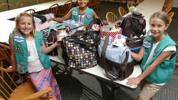 Girl Scouts help out Kid's House