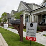 A sold sign is displayed in the yard of a newly constructed home in the Briar Chapel community in Chapel Hill, N.C.
