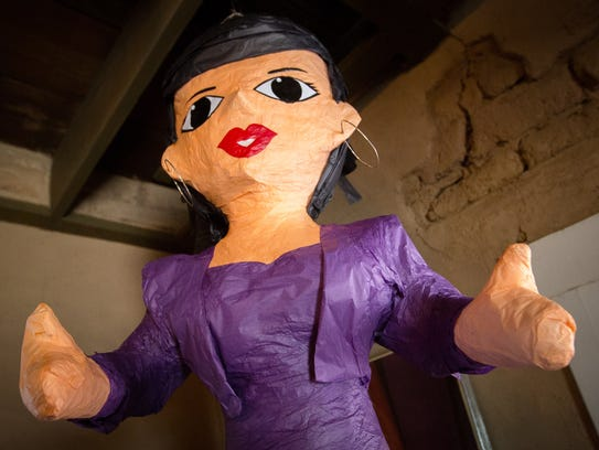 A piñata made in the likeness of the late singer Selena