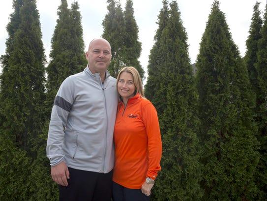 Jason and Tammi Carr outside their Ann Arbor home on