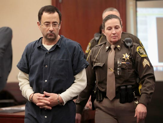 Larry Nassar appears in court to listen to victim-impact statements prior to being sentenced on January 16, 2018, in Lansing.