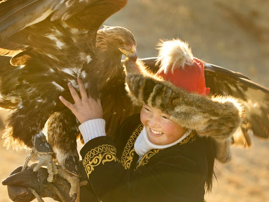 """""""The Eagle Huntress"""" is a documentary about a 13-year-old (Aisholpan Nurgaiv) training to become an eagle hunter."""