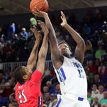 FGCU's Antravious Simmons shoots over NJIT's Terrence Smith during FGCU's 82-78 overtime win Jan. 14 in Alico Arena.