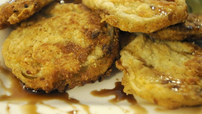 Fried green tomatoes with balsamic reduction.