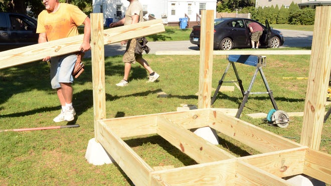 Jim Paquin, left, and Rich Demars, Danielson Elks members, build a donated handicap ramp Friday for Brooklyn resident June Boswell. See videos and more photos at NorwichBulletin.com