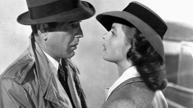 "Humphrey Bogart, left, as Rick, and Ingrid Bergman, right, as Ilsa in ""Casablanca."" The Indianapolis Symphony Orchestra will perform the score alongside the film Feb. 13-15."