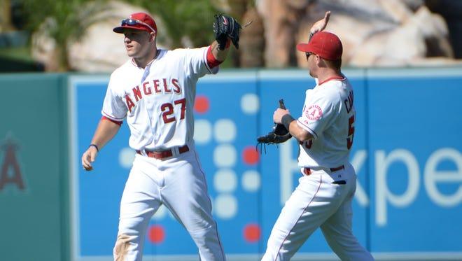 Mike Trout, left, and Kole Calhoun celebrate at Angel Stadium of Anaheim.