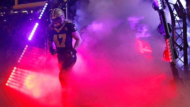 NEW ORLEANS, LA - NOVEMBER 4:  Alex Anzalone #47 of the New Orleans Saints run out of the tunnel before a game against the Los Angeles Rams at Mercedes-Benz Superdome on November 4, 2018 in New Orleans, Louisiana.  The Saints defeated the Rams 45-35.  (Photo by Wesley Hitt/Getty Images)