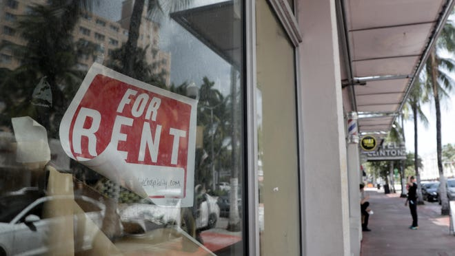 FILE - In this July 13, 2020 file photo, a For Rent sign hangs on a closed shop during the coronavirus pandemic in Miami Beach, Fla.  Having endured what was surely a record-shattering slump last quarter, the U.S. economy faces a dim outlook as a resurgent coronavirus intensifies doubts about the likelihood of any sustained recovery the rest of the year.