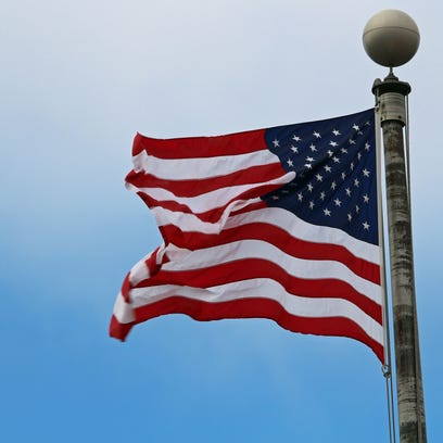An American flag blows in the wind.