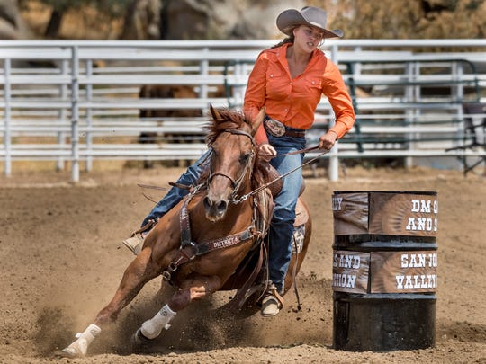 Lizzie Stewart competes with her horse Dennis in barrel racing at the Woodlake Rodeo Grounds on Sunday, July 8, 2018. Stewart, 18, and her Quarter Horse won the 2018 State Barrel Racing Championship and are headed to nationals in Wyoming this month.