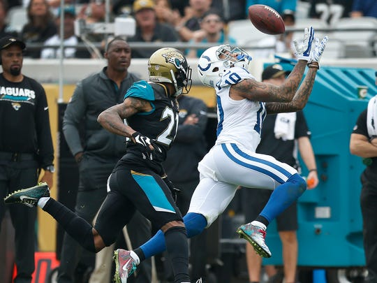 Indianapolis Colts wide receiver Donte Moncrief (10) makes a catch behind Jacksonville Jaguars cornerback A.J. Bouye (21) in the second half of their game at EverBank Field on Sunday, Dec. 03, 2017.