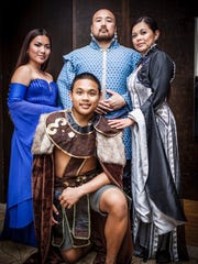"""""""House Analista"""" includes members of the Analista family who all wore costumes inspired by the hit HBO series """"Game of Thrones."""" Norman Analista, center, says throwing a big event is all about planning."""