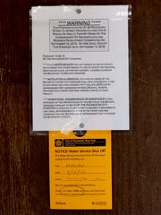A closure notice is tacked up at 36 Woodward St., where two people were fatally shot at a house party on Sept. 12, 2015.