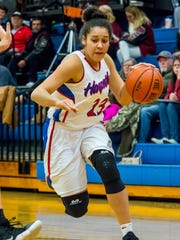 Harpeth's Katelynn Staed dribbles to the basket during Harpeth's loss to Cheatham County.