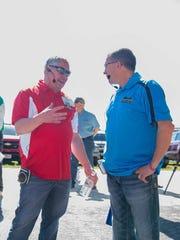 2017 Farm Technology Days host Randy Ebert (right) listens to John Pagel (left) before giving a tour at Ebert Enterprises on Media Day.