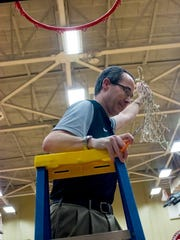 Cheatham County coach Jim Gibbs grabs the net after