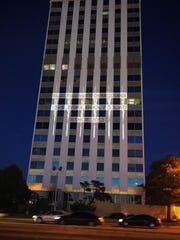 A ticker counting tax dollars allegedly lost to methane waste is projected on the side of a building, Monday in downtown Albuquerque.