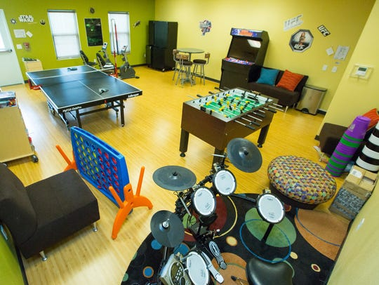 A game room at the Middle School & Teen facility is