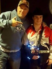 Andy Bushey and Garth Brooks pose for a photo after a concert last week.