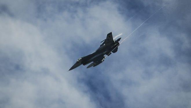 A Vermont Air National Guard F-16 fighter jet circles Burlington International Airport before landing on Wednesday.