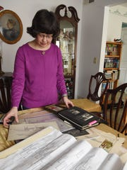 Toni Houston looks over some familial artifacts she's